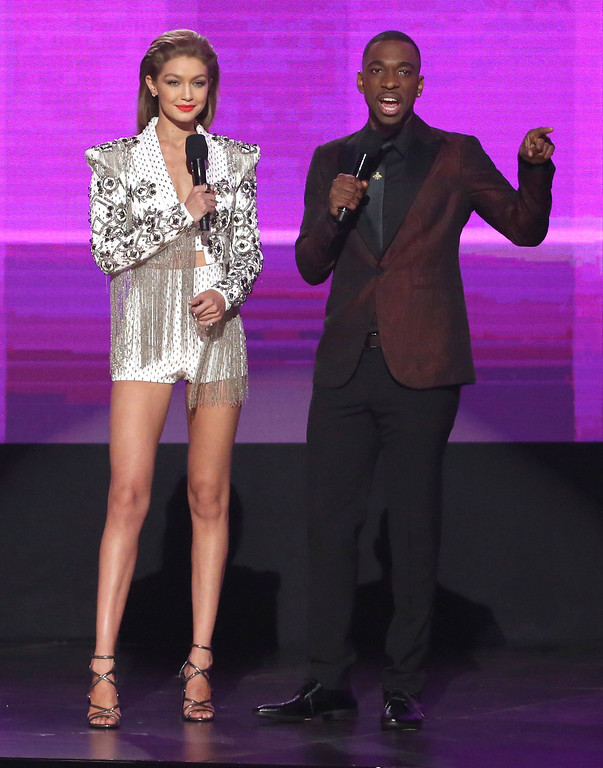 . Hosts Gigi Hadid, left, and Jay Pharoah appear at the American Music Awards at the Microsoft Theater on Sunday, Nov. 20, 2016, in Los Angeles. (Photo by Matt Sayles/Invision/AP)