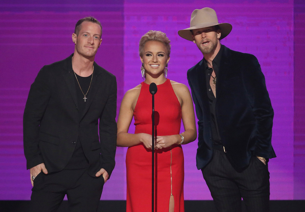 . Miss America Savvy Shields, center, and Tyler Hubbard, left, and Brian Kelley, of Florida Georgia Line, present the award for collaboration of the year at the American Music Awards at the Microsoft Theater on Sunday, Nov. 20, 2016, in Los Angeles. (Photo by Matt Sayles/Invision/AP)
