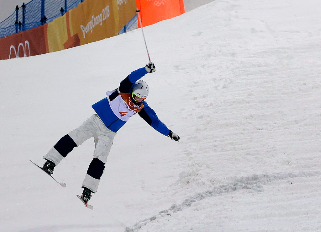 . Choi Jae-woo, of South Korea, crashes during the men\'s moguls qualifying at Phoenix Snow Park at the 2018 Winter Olympics in Pyeongchang, South Korea, Monday, Feb. 12, 2018. (AP Photo/Kin Cheung)