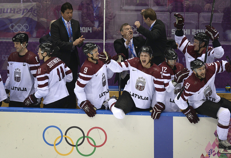 . Latvian players celebrate a 3-1 victory during the Men\'s Ice Hockey Play-offs Switzerland vs Latvia at the Bolshoy Ice Dome during the Sochi Winter Olympics on February 18, 2014.  (ALEXANDER NEMENOV/AFP/Getty Images)