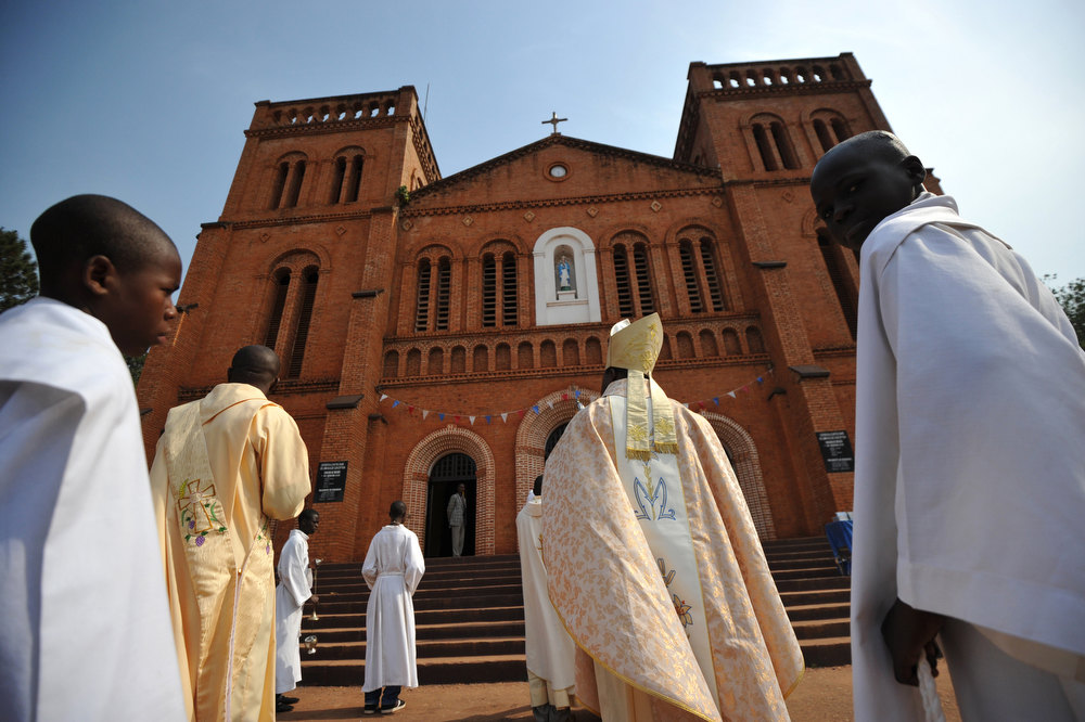 Description of . Nzapalainga Dieudonne, bishop of Bangui (C), arrives at the cathedral in Bangui to conduct a mass, on January 1, 2013. The death of a young Muslim man arrested for alleged links to rebels in the Central African Republic sparked clashes on January 1, 2013 in the capital that killed a policeman, a police source said. The unrest erupted as countries in the region sent reinforcements to protect the capital Bangui from rebels who control much of the country and are demanding the departure of President Francois Bozize. SIA KAMBOU/AFP/Getty Images
