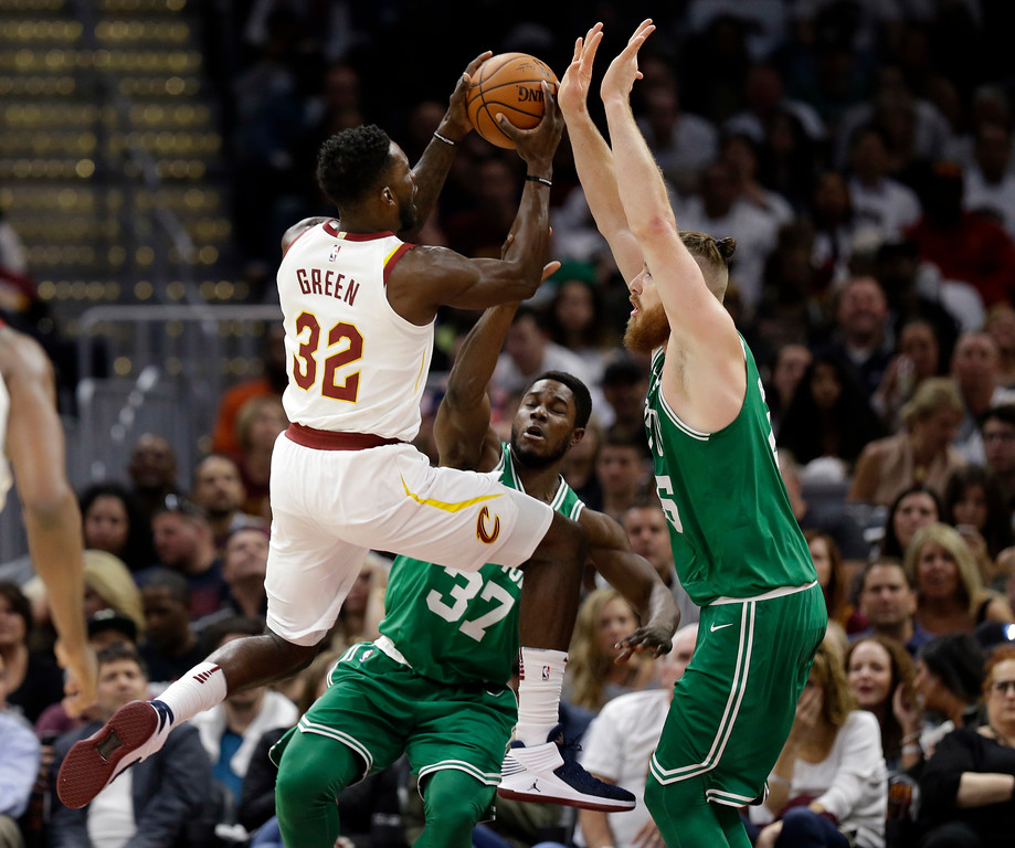 . Cleveland Cavaliers\' Jeff Green (32) drives against Boston Celtics\' Aron Baynes (46), from Australia, and Semi Ojeleye (37) in the first half of an NBA basketball game, Tuesday, Oct. 17, 2017, in Cleveland. (AP Photo/Tony Dejak)