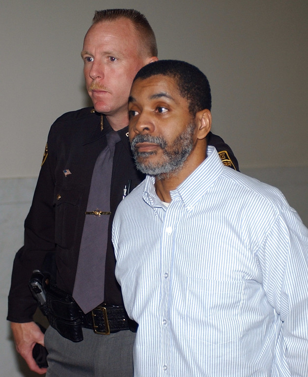 . Inmate James Were, right, is led handcuffed to court Tuesday, May 13, 2003, in Cincinnati, in his retrial for the aggravated murder of guard Robert Vallandingham during a 1993 prison riot at the Southern Ohio Correctional Facility near Lucasville, Ohio. (AP Photo/Al Behrman)
