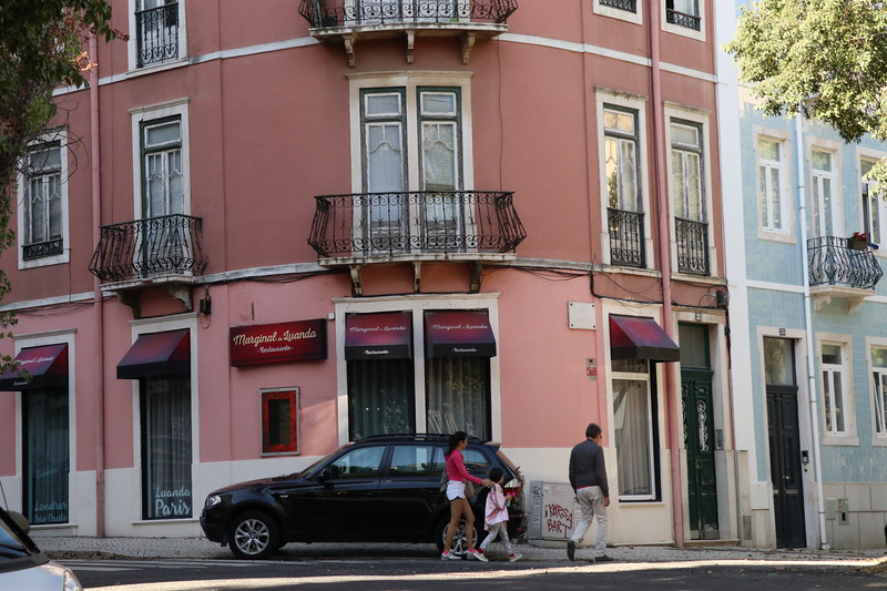 Exploring the brightly colored Lisbon neighborhood