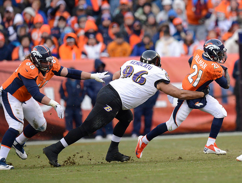 . Denver Broncos running back Ronnie Hillman (21) makes a run in the second quarter. The Denver Broncos vs Baltimore Ravens AFC Divisional playoff game at Sports Authority Field Saturday January 12, 2013. (Photo by Joe Amon,/The Denver Post)