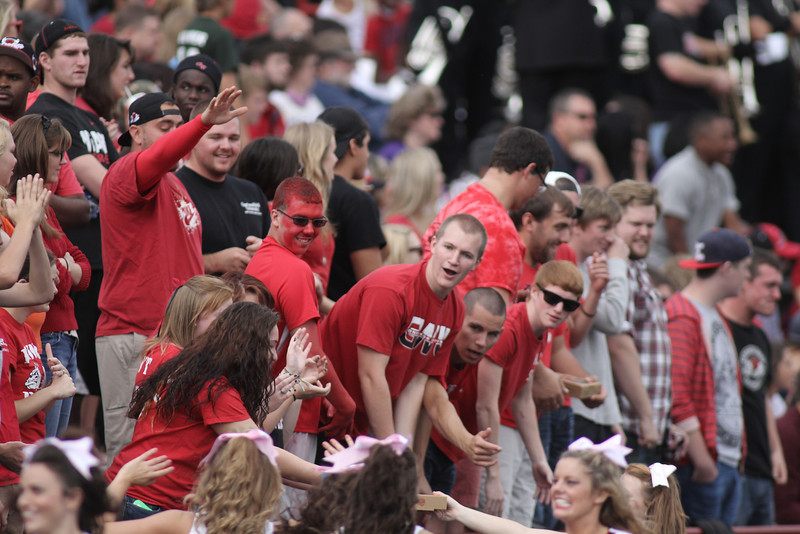 The Gardner-Webb student section cheers as the cheerleaders pass out pizzas