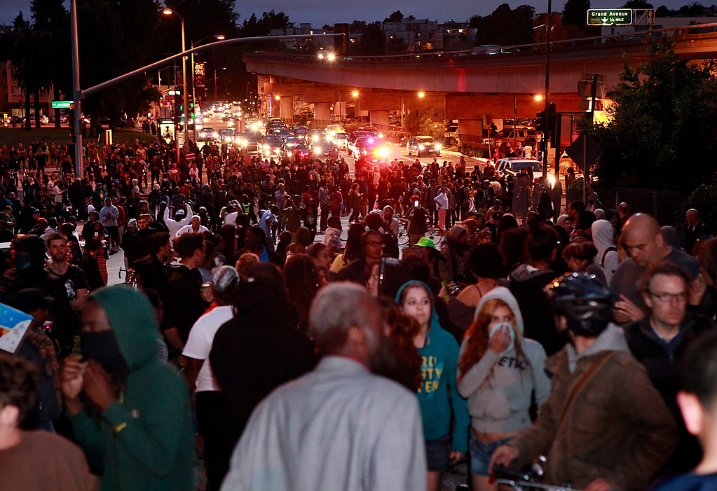 . Hundreds of people marched to Grand Avenue on the third day of protesting over the acquittal of George Zimmerman Monday evening, July 15, 2013 in Oakland, Calif. (Karl Mondon/Bay Area News Group)