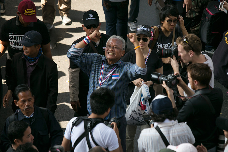 """. People\'s Democratic Reform Committee (PDRC) leader Suthep Thaugsuban (center) parades in downtown Bangkok on the first day of the \"""" Bangkok Shutdown \"""", Thailand on January 13, 2014. Anti-government protesters launch \""""Bangkok Shutdown\"""", blocking major intersections in the heart of the capital, as part of their bid to oust the government of Prime Minister Yingluck Shinawatra ahead of elections scheduled to take place on February 2. (Photo by Paula Bronstein/Getty Images)"""