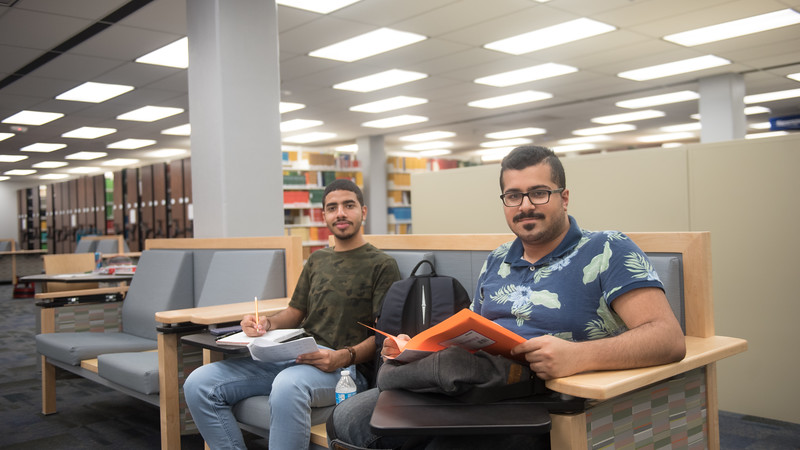 Mahdi Alnejaidi (left) and Ahmed Almajid study for their mathematics test in the Mary and Jeff Bell Library.