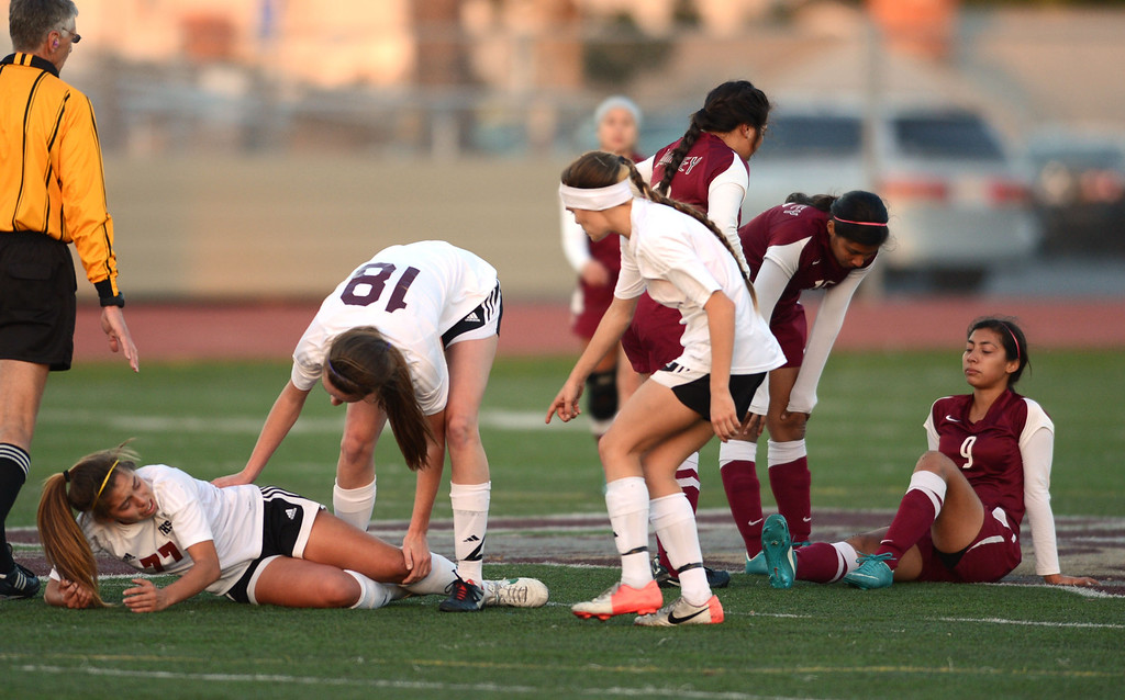. The game was physical as Torrance\'s Anika Rodriguez (77) and Downey\'s Maritza Acuna (9) both are shaken-up after a collision in a CIF SS Division IV quarterfinal game Thursday at Zamperini Field. Downey won the game 3-1. 20130221 Photo by Steve McCrank / Staff Photographer