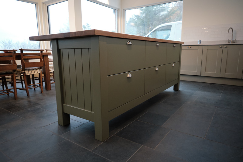 Custom made 2400mmx950 island table fitted with 6 full extensions drawers,, fully spray painted.
