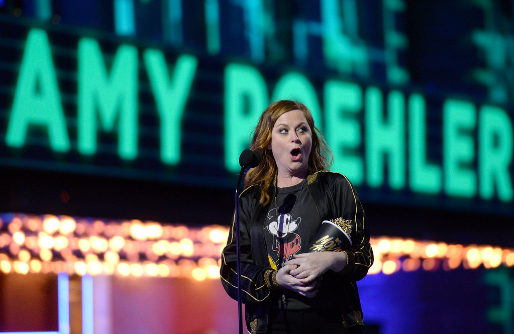 . Amy Poehler accepts the award for best virtual performance for �Inside Out� at the MTV Movie Awards at Warner Bros. Studio on Saturday, April 9, 2016, in Burbank, Calif. (Kevork Djansezian/Pool Photo via AP)