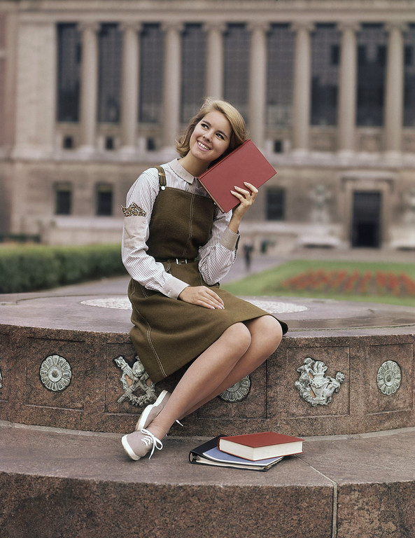 . Brown college dress gray and white shirt with sneakers fashion college dress in 1963. (AP Photo)