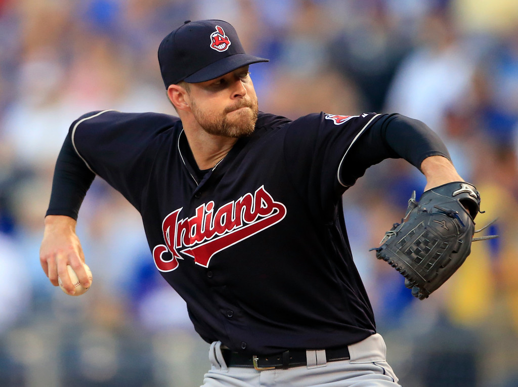 . Cleveland Indians starting pitcher Corey Kluber delivers to a Kansas City Royals batter during the first inning of a baseball game at Kauffman Stadium in Kansas City, Mo., Friday, Aug. 18, 2017. (AP Photo/Orlin Wagner)