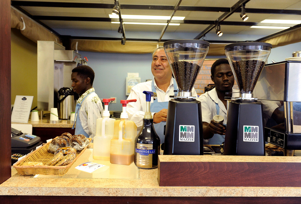 . Khaled Murtada greets customers at Emily\'s Coffee on June 20, 2013, in Denver, Colorado. The coffee shop, part of Emily Griffith Technical College, offers refugees and immigrants hands on, job-training experience. All proceeds from the full-service coffee shop benefit the college. (Photo by Anya Semenoff/The Denver Post)