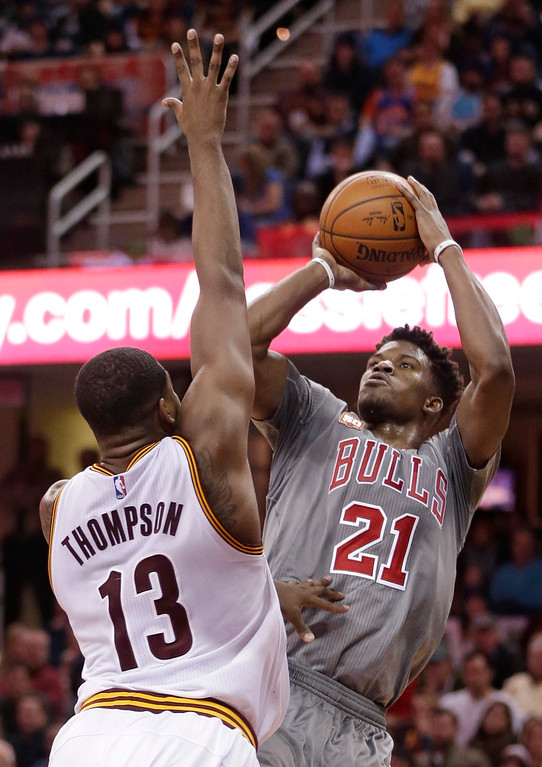 . Chicago Bulls\' Jimmy Butler (21) shoots over Cleveland Cavaliers\' Tristan Thompson (13), from Canada, in the second half of an NBA basketball game Saturday, Jan. 23, 2016, in Cleveland. The Bulls won 96-83. (AP Photo/Tony Dejak)