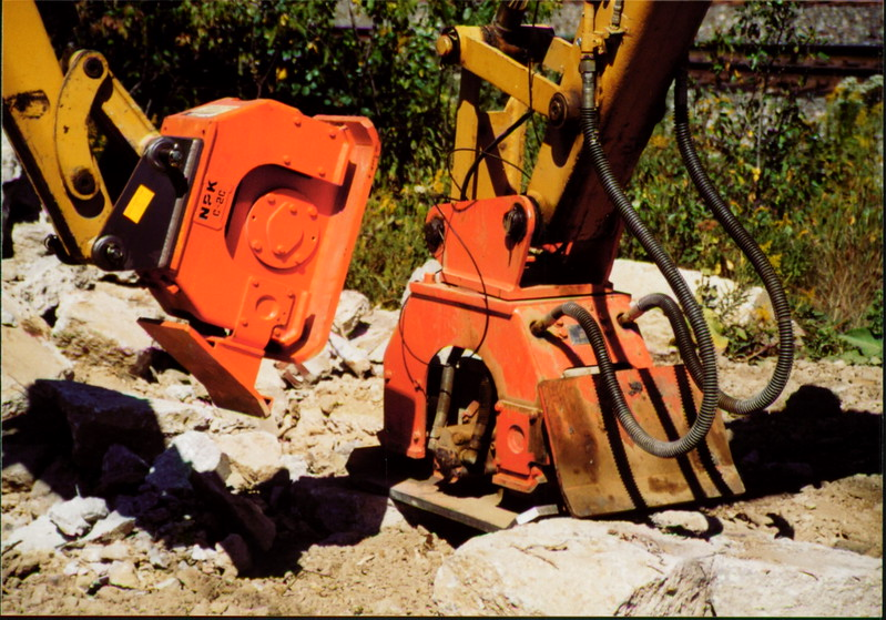 NPK C2C and C4C compactors with backfill blades on Cat mini excavators (2).JPG