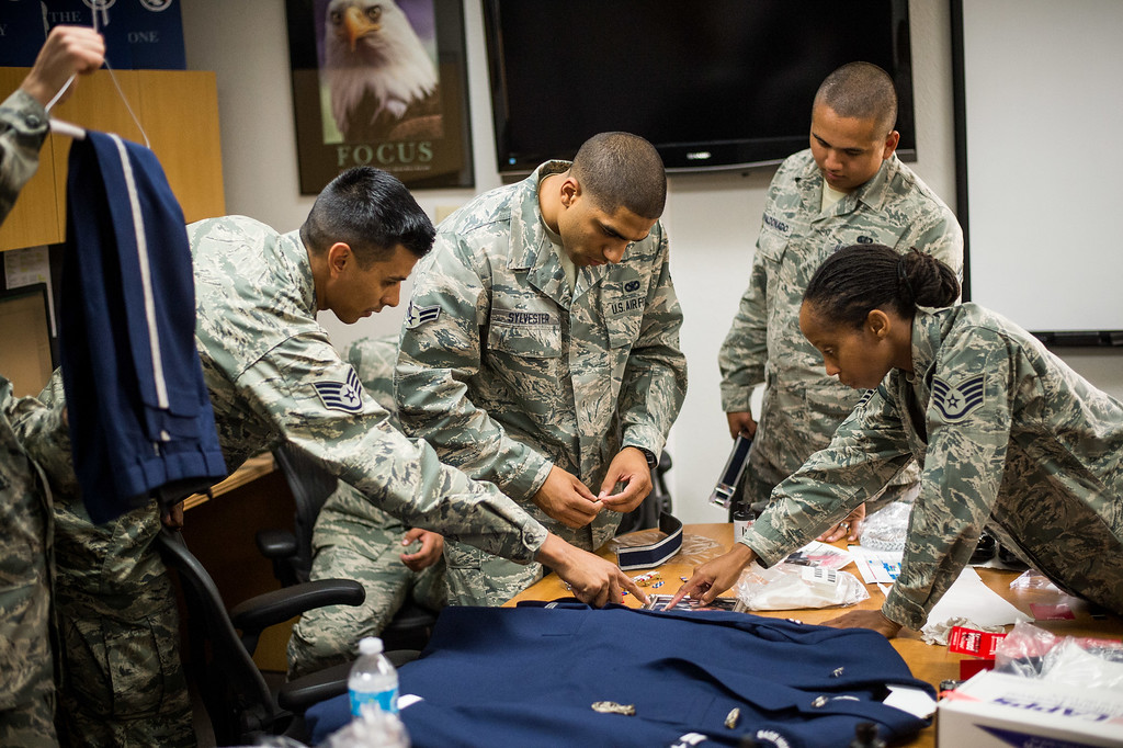 . Airman First Class Brenden Sylvester, center, gets help on his ceremonial uniform from fellow Blue Eagles Honor Guard at March Air Reserve Base in Riverside, Calif. on Monday, May 18, 2015. (Photo by Watchara Phomicinda/ Los Angeles Daily News)