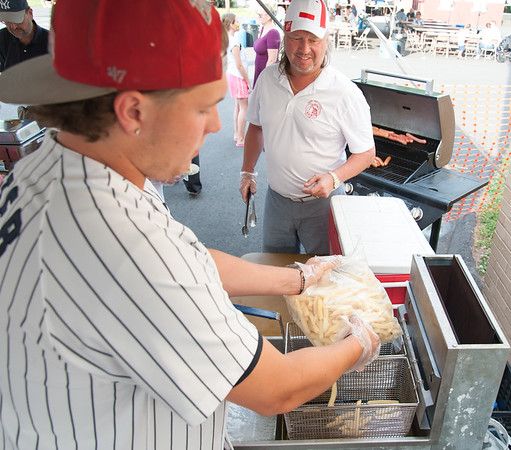 06/21/18 Wesley Bunnell | Staff Darek Wiecki staffs the fry station on the first night of the Sacred Heart Parish Festival on Friday evening.