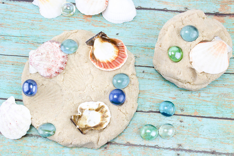 mix in shells and glass stones