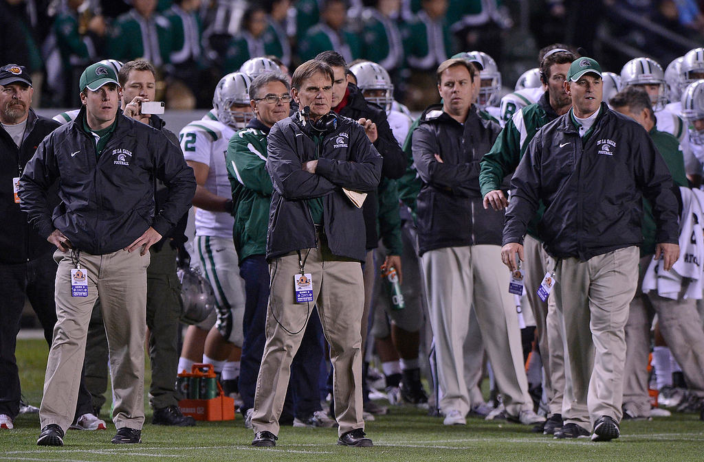 . De La Salle Spartans\' head coach Bob Ladouceur (second from left) watches his players while playing the Centennial Huskies in the first quarter of the Open Division during the 2012 CIF State Football Championship at Home Depot Center in Carson , Calif. on Saturday, Dec. 15, 2012. (Jose Carlos Fajardo/Staff)
