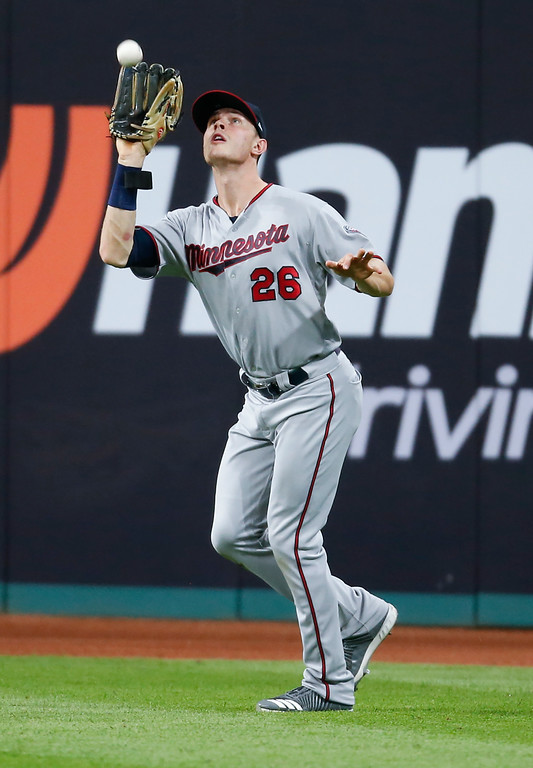 . Minnesota Twins\' Max Kepler makes a catch to get out Cleveland Indians\' Jason Kipnis during the third inning in a baseball game, Tuesday, Sept. 26, 2017, in Cleveland. (AP Photo/Ron Schwane)