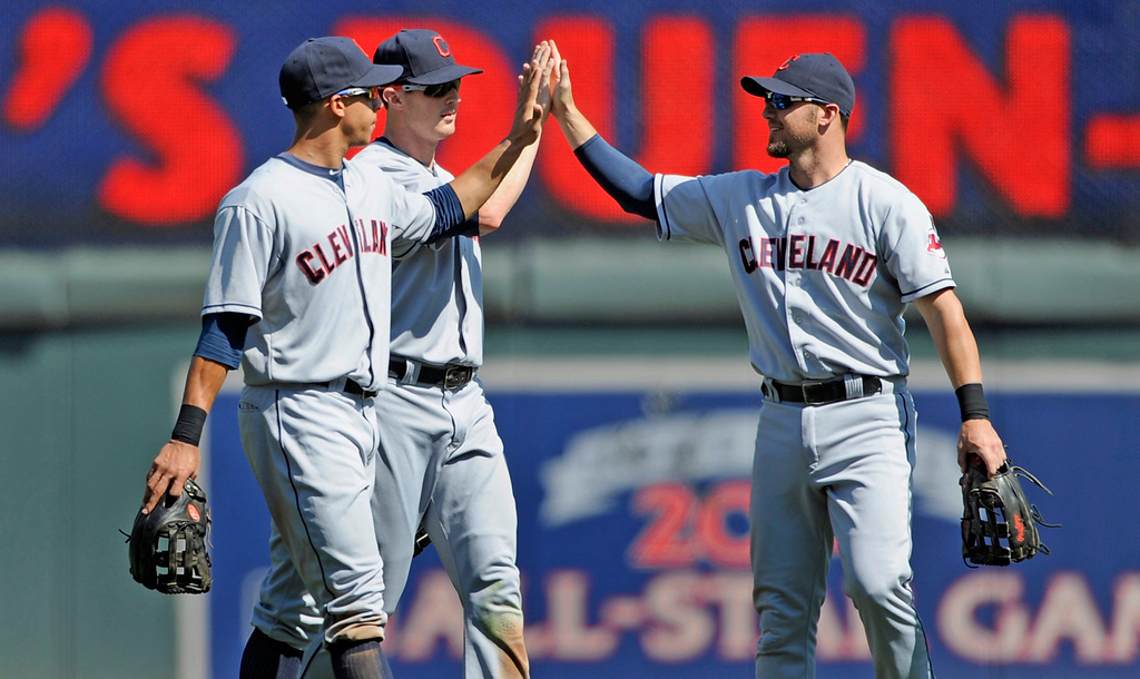 . Cleveland outfielders (from left) Michael Brantley, Drew Stubbs and Ryan Raburn celebrate their 7-1 win over the Twins at Target Field in Minneapolis on Sunday July 21, 2013. (Photo by Hannah Foslien/Getty Images)
