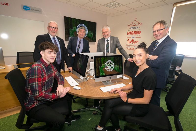12/03/2019. Digital Innovation Lab Sponsored by Salesforce officially opens in Waterford Institute of Technology. The 32 desk lab has been designed to inspire collaboration and interactivity, to bring the 4th industrial revolution to life for the students of WIT. Both Teachers and Students will use Salesforce Technology to supplement and enhance their digital media education. Pictured are School of Business Students Charlotte Cuddihy and Aaron Keogh with Dr David Dempsey Salesforce, Minister John Halligan TD, Jim Moore Chair of the WIT Governing Body and Prof. Willie Donnelly, President of WIT. Picture: Patrick Browne