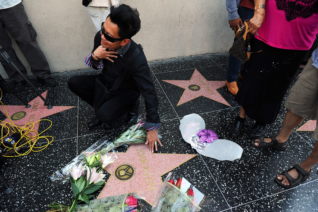 . Visitors pose for photos at Joan Rivers star on the Hollywood Walk of Fame after her passing Thursday, September 4, 2014.(Andy Holzman/Los Angeles Daily News)