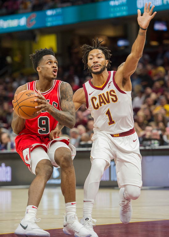 . Chicago Bulls\' Antonio Blakeney (9) prepares to shoot past Cleveland Cavaliers\' Derrick Rose (1) during the first half of an NBA preseason basketball game in Cleveland, Tuesday, Oct. 10, 2017. (AP Photo/Phil Long)