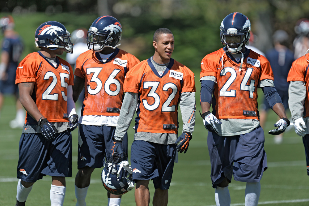 . Chris Harris (25) CB Kayvon Webster (36) CB Tony Carter (32) CB and Champ Bailey (24) CB of the Denver Broncos head to the next station during OTAs June 3, 2013 at Dove Valley. (Photo By John Leyba/The Denver Post)
