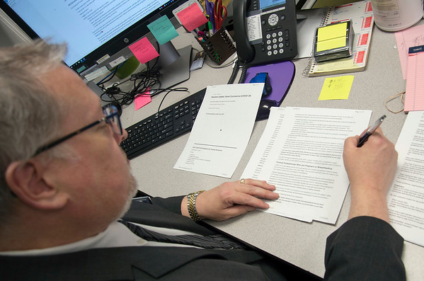 03/19/20 Wesley Bunnell | StaffrrRobert Bruzy of New Britain Memorial - Sagarino Funeral Home looks over the most recent paperwork guidelines from the CDC which was received later in the day on Thursday March 19, 2020.