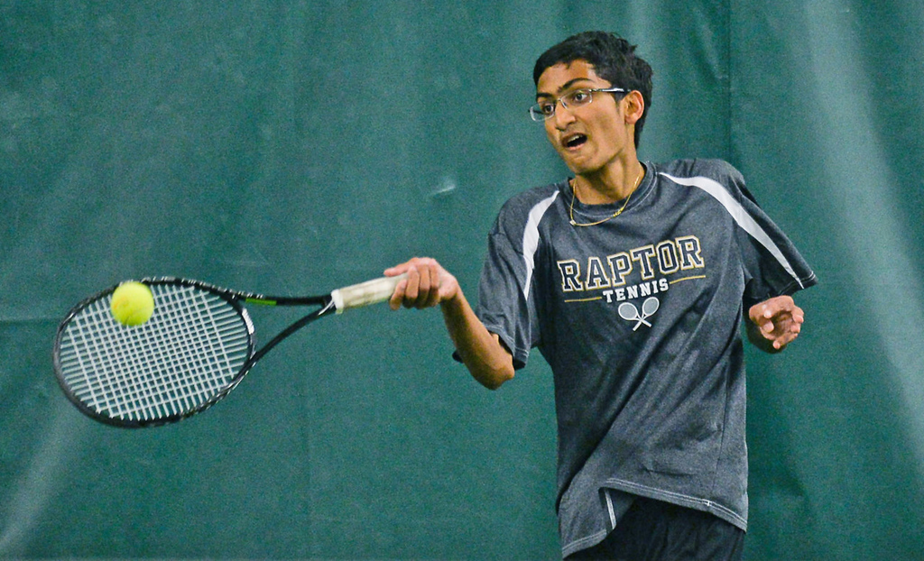 . Nikhil Gupta returns a serve from Abraham Alex of Mounds View in the State Class AA Boys\' Tennis Tournament team quarterfinals. (Pioneer Press: Ben Garvin)
