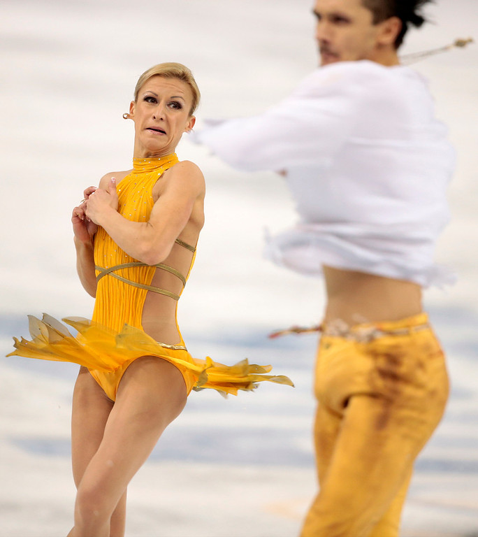 . Tatiana Volosozhar and Maxim Trankov of Russia compete in the pairs free skate figure skating competition at the Iceberg Skating Palace during the 2014 Winter Olympics, Wednesday, Feb. 12, 2014, in Sochi, Russia. (AP Photo/Ivan Sekretarev)