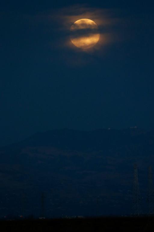 . The supermoon  is seen over Mount Hamilton on Sunday, Aug.10, 2014. (Josie Lepe/Bay Area News Group)