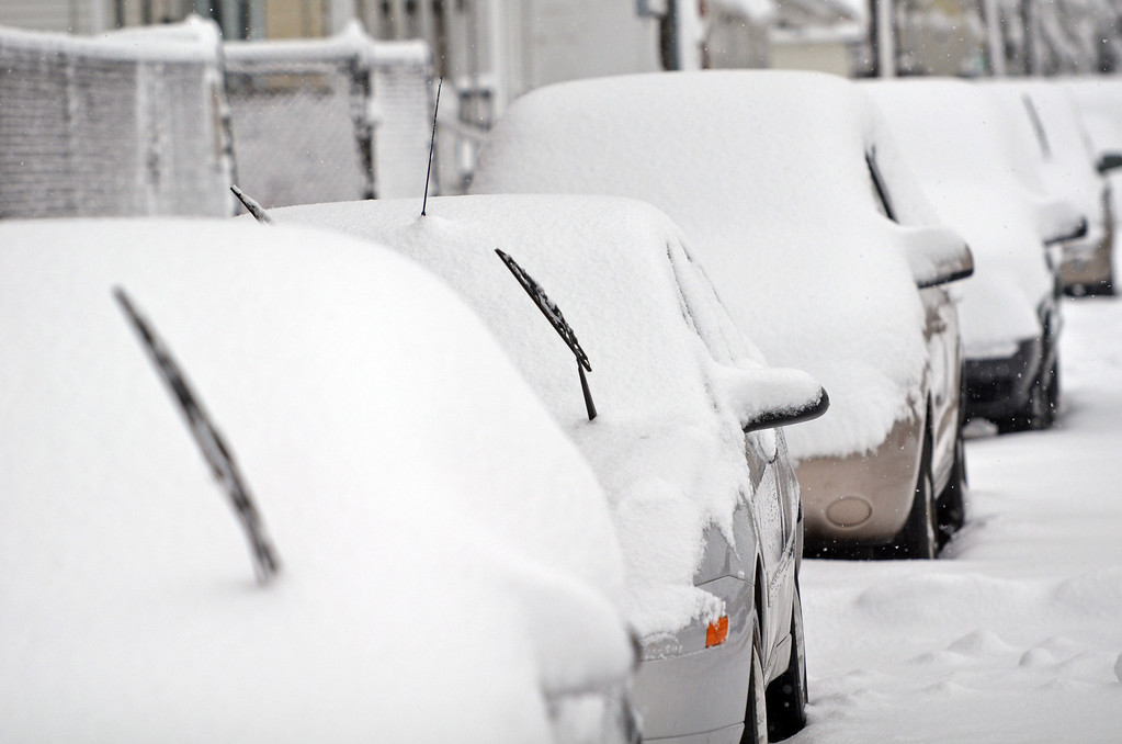 . Snow covered cars line St.Elmo Street in Lansdale.   Monday, Februrary 3, 2014.  Photo by Geoff Patton