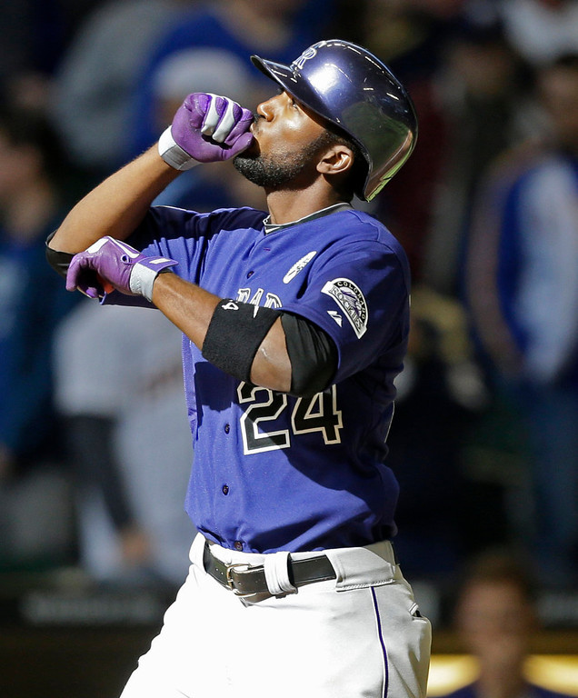 . Colorado Rockies\' Dexter Fowler reacts after his home run against the Milwaukee Brewers in the ninth inning of an opening day baseball game  Monday, April 1, 2013, in Milwaukee. (AP Photo/Jeffrey Phelps)