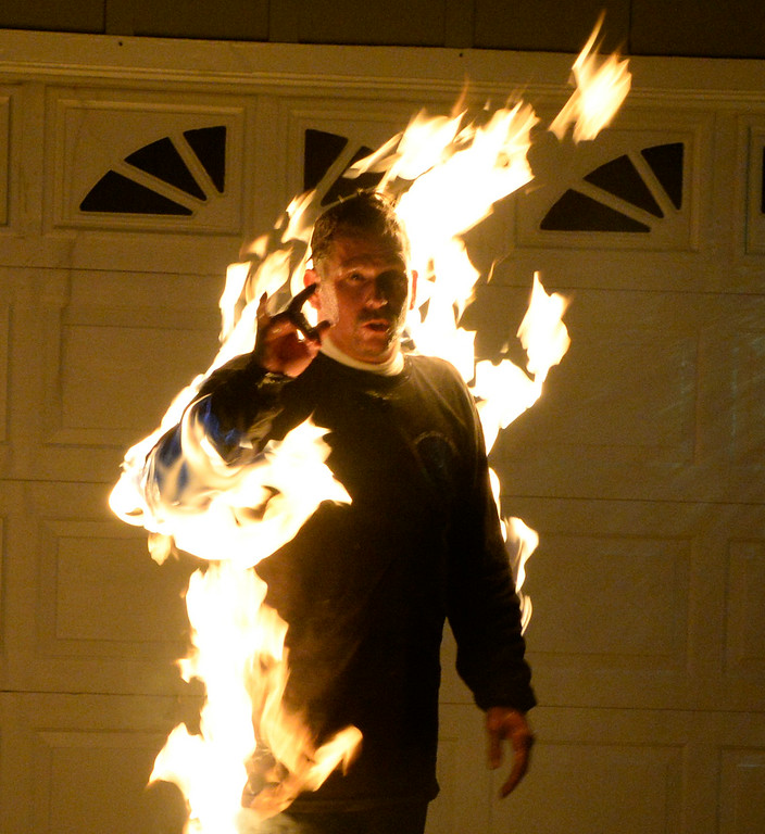 . Aug 23,2014, West Hils CA. Moorpark resident Tommy Primeau a Hollywood  stuntman lights himself on fire (wearing all the protective gear of course) and take the ice bucket challenge for ALS. Photo by Gene Blevins/LA Daily News