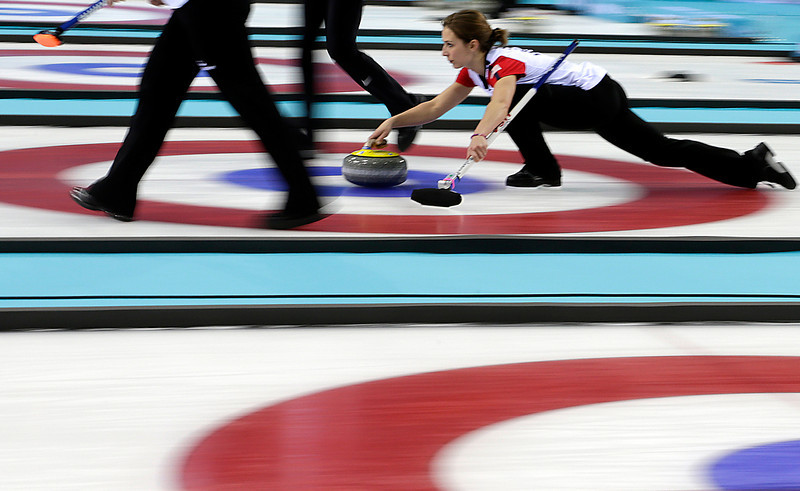 . Jessica Shultz of the United States delivers the stone during the women\'s curling competition against Russia at the 2014 Winter Olympics, Tuesday, Feb. 11, 2014, in Sochi, Russia. (AP Photo/Wong Maye-E)