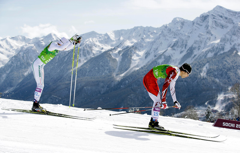 . Japan\'s Yuichi Onda leads Bulgaria\'s Veselin Tsinzov during the cross-country team sprint competitions at the 2014 Winter Olympics, Wednesday, Feb. 19, 2014, in Krasnaya Polyana, Russia. (AP Photo/Lee Jin-man)