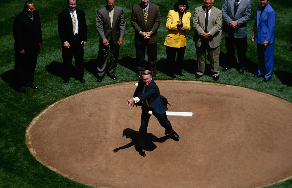 . LOS ANGELES - APRIL 5:  Vin Scully throws out the first pitch on Opening Day before the Los Angeles Dodgers game against the Arizona Diamondbacks at Dodger Stadium on April 5, 1999 in Los Angeles, California. (Photo by Donald Miralle/Getty Images)