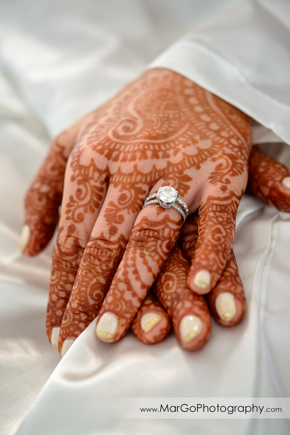 engagement ring on bride's henna hand in DoubleTree by Hilton Pleasanton at the Club