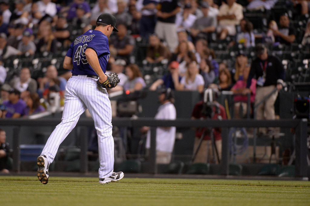 . Colorado Rockies relief pitcher Rex Brothers (49) heads to the dugout after getting pulled in the ninth inning against the Arizona Diamondbacks June 4, 2014 at Coors Field. (Photo by John Leyba/The Denver Post)