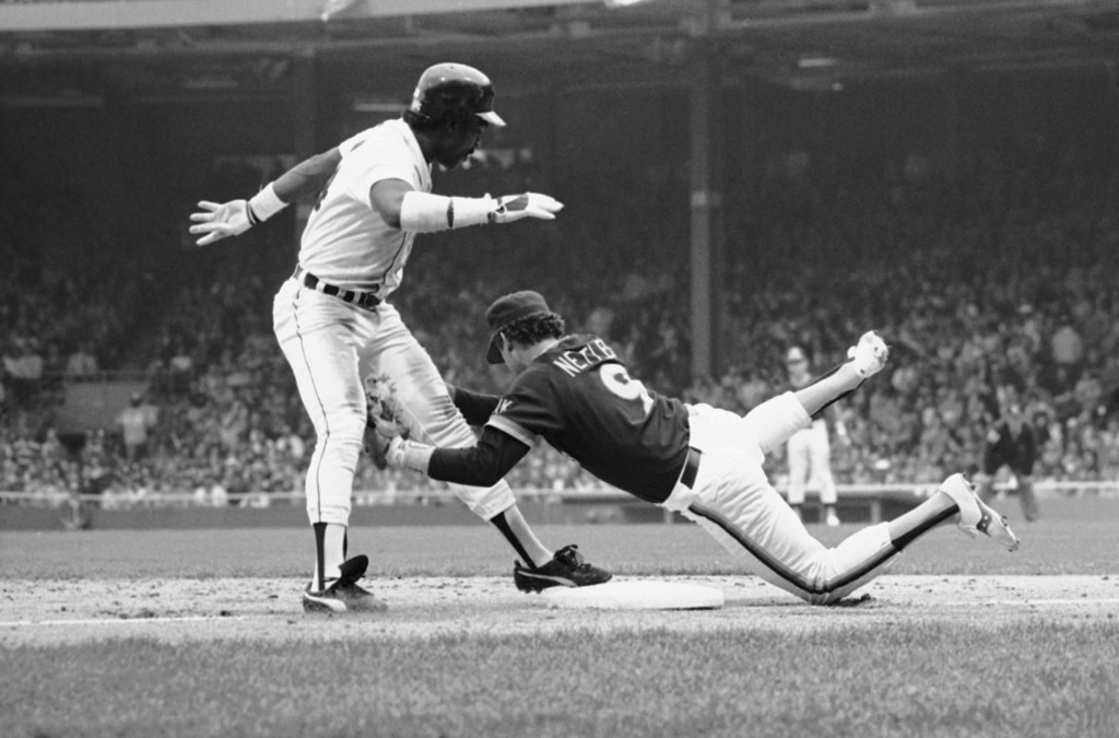 . Detroits Chet Lemon, left, is tagged by San Diego third baseman Graig Nettles, trying to steal third, in the fourth inning of a World Series game, Saturday, Oct. 13, 1984, Detroit, Mich. (AP Photo/Rusty Kennedy)