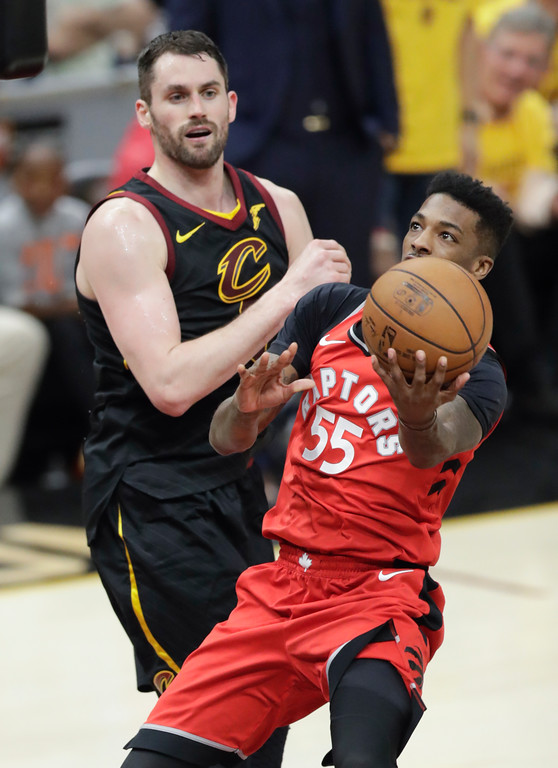 . Toronto Raptors\' Delon Wright (55) shoots past Cleveland Cavaliers\' Kevin Love in the second half of Game 4 of an NBA basketball second-round playoff series, Monday, May 7, 2018, in Cleveland. (AP Photo/Tony Dejak)