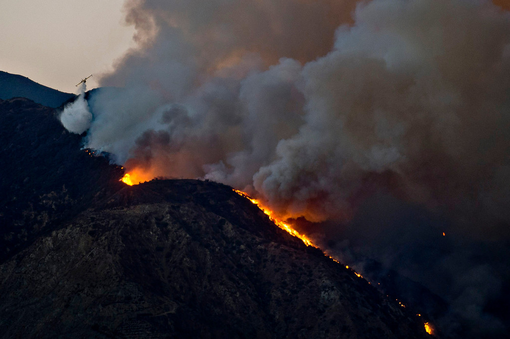 . A Super Scooper makes a water drop at the Madre Fire in the Angeles National Forest above Azusa, Calif. on Monday evening, Sept. 23, 2013. (Photo by Watchara Phomicinda/ San Gabriel Valley Tribune)