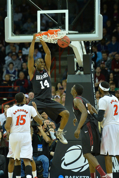 March 20, 2014: Harvard Crimson forward Steve Moundou-Missi (14) dunks during a second round game of the NCAA Division I Men's Basketball Championship between the 5-seed Cincinnati Bearcats and the 12-seed Harvard Crimson at Spokane Arena in Spokane, Wash. Harvard defeated Cincinnati 61-57.