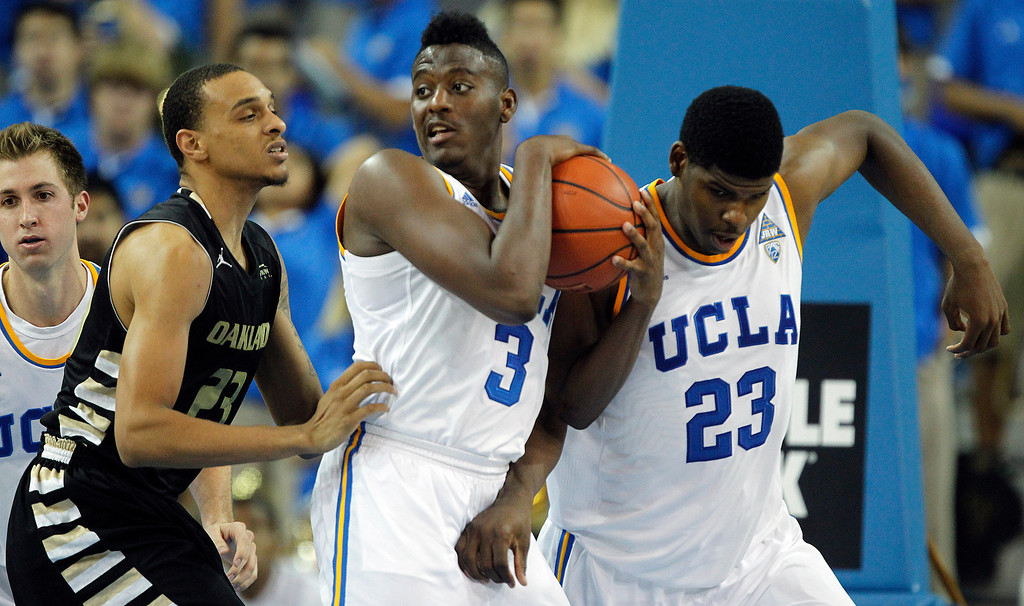 . UCLA guard Jordan Adams (3) pulls down a rebound between Oakland forward Tommie McCune, left, and UCLA\'s Tony Parker, right, during the second half of their NCAA college basketball game Tuesday, Nov. 12, 2013, in Los Angeles. UCLA won 91-60. (AP Photo/Alex Gallardo)