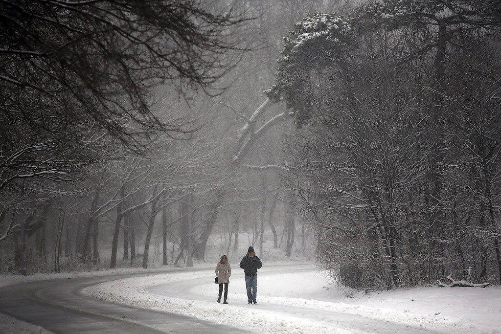 . People walk through a snow-shrouded park on March 8, 2013 in the Brooklyn borough of New York City.  (Photo by Spencer Platt/Getty Images)