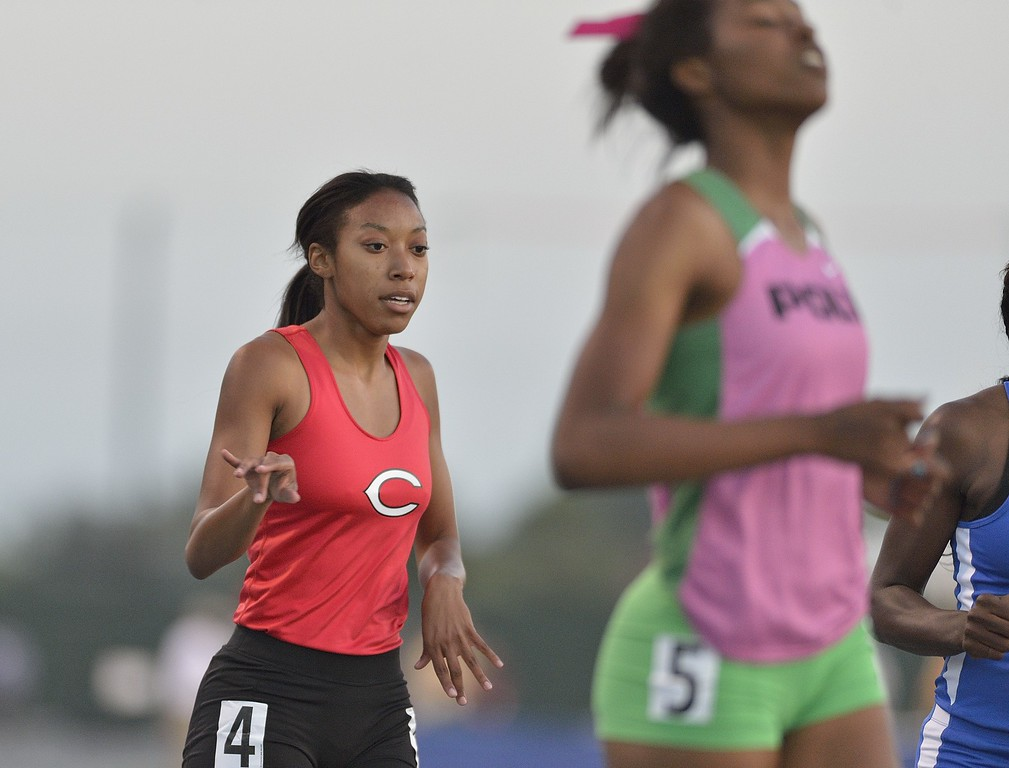 . NORWALK, CALIF. USA -- Poly\'s Arianna Washington right, and Centennial\'s Eboni Sutherland finish the 200 meter dash during the CIF-SS Masters Track and Field Meet in Norwalk, Calif., on Friday, May 24, 2013. Photo by Jeff Gritchen / Los Angeles Newspaper Group